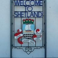 Welcome to Shetland Sign, featuring a Viking ship and Norse motto